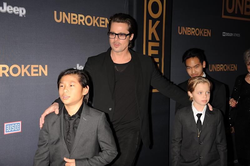 Brad Pitt and kids at red carpet for Unbroken