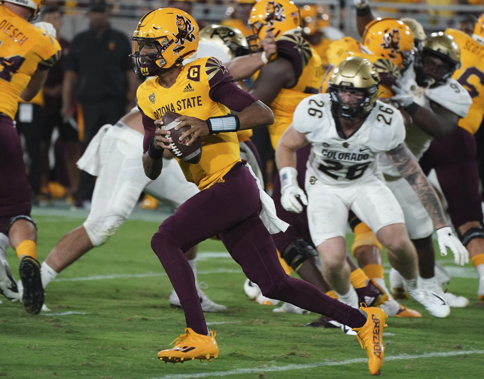Arizona State quarterback Jayden Daniels (5) runs for a first down against Colorado State's defense during the first half of an NCAA college football game Saturday, Sept 25, 2021, in Tempe, Ariz. (AP Photo/Darryl Webb)
