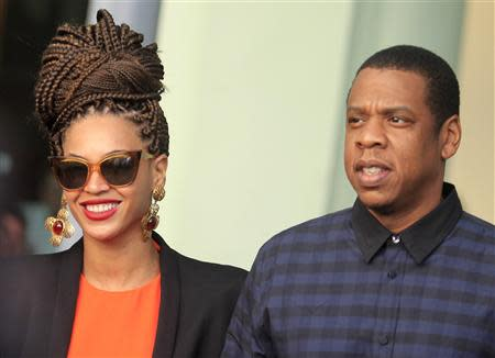 U.S. singer Beyonce (L) and her husband rapper Jay-Z walk as they leave their hotel in Havana in this April 4, 2013 file photo. REUTERS/Enrique De La Osa/Files