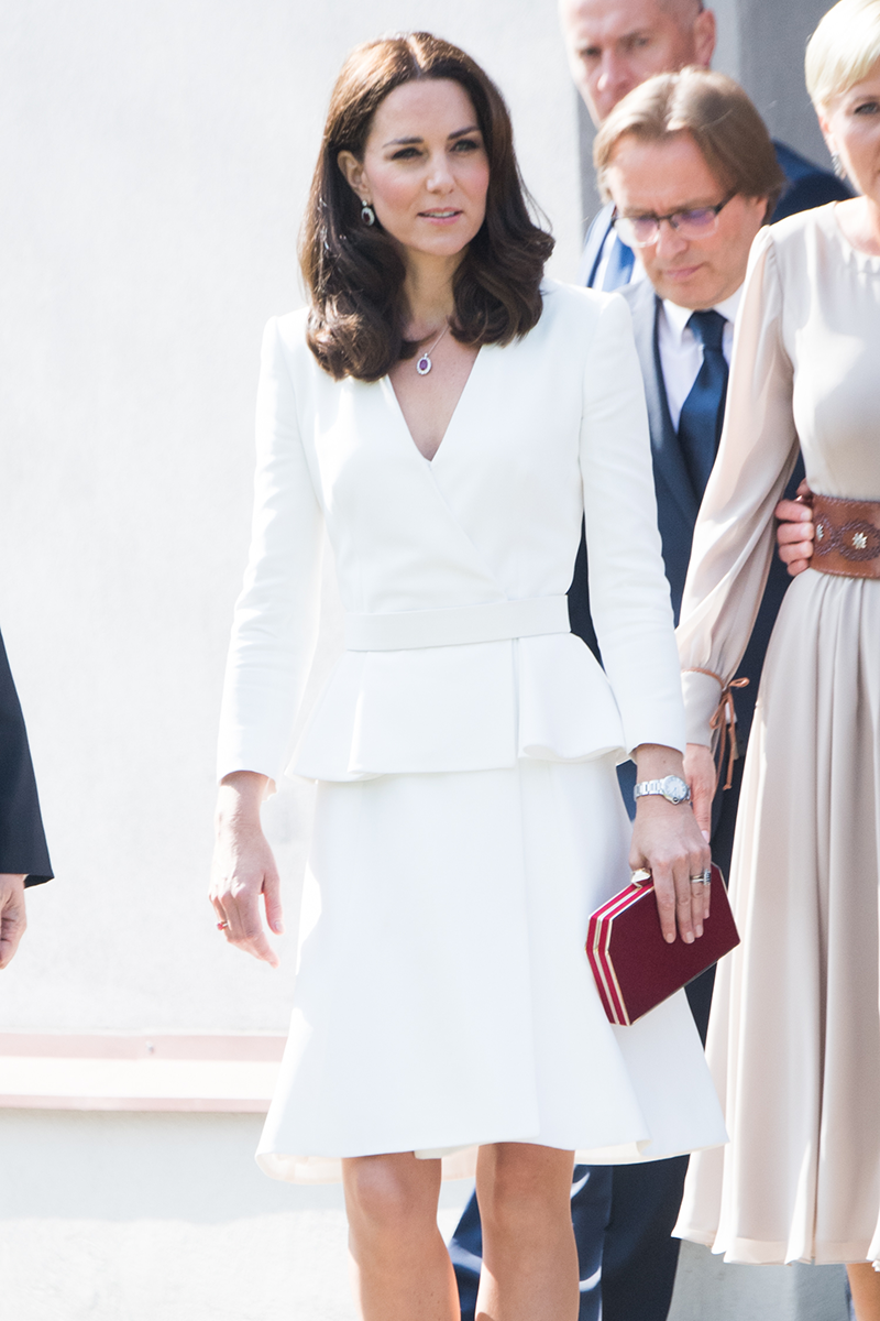 <p>Kate brought the look into modern day, swapping the buttons and tapered skirt for a minimalist, more relaxed fit for the royals' trip to Poland in July 2017.</p>
