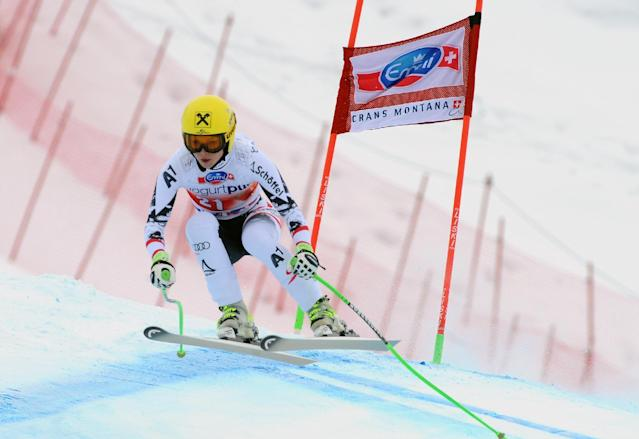 Austria's Anna Fenninger clears a gate on her way to take second place in an alpine ski, World Cup women's downhill, in Crans Montana, Switzerland, Sunday, March 2, 2014. (AP Photo/Pier Marco Tacca)