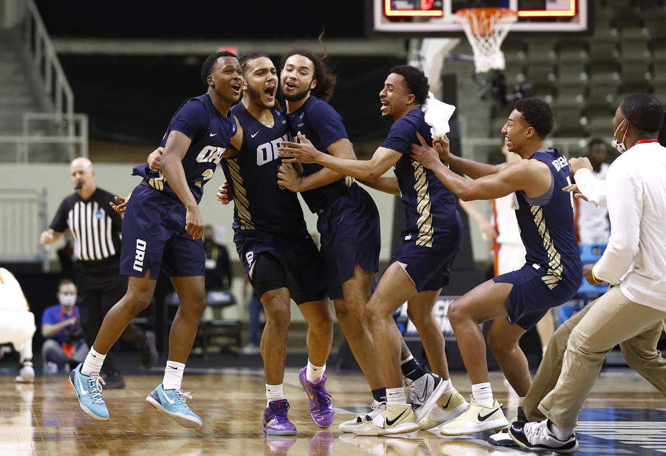 Max Abmas, Kevin Obanor and Kareem Thompson of Oral Roberts celebrate after defeating Florida on March 21. (Maddie Meyer/Getty Images)