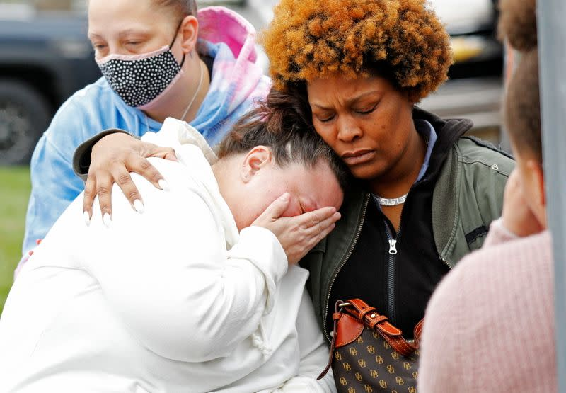 The family of Daunte Wright mourn at a vigil, days after he was fatally shot by former police officer Kim Potter at a traffic stop, in Brooklyn Center, Minnesota