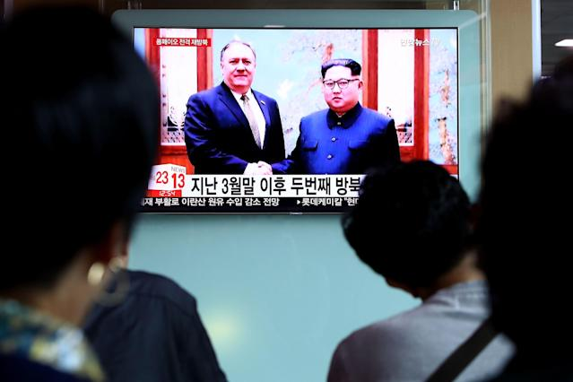 <p>South Koreans watch on a screen reporting the Secretary of State Mike Pompeo visit to North Korea at the Seoul Railway Station on May 9, 2018 in Seoul, South Korea. (Photo: Chung Sung-Jun/Getty Images) </p>