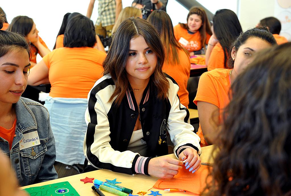 <p>School was in for Gomez, as the singer surprised students at two L.A. high schools with a talk about empowerment and the importance of self-love. The celebrity ambassador for Coach made the visits on behalf of the designer brand and the nonprofit Step Up Foundation. (Photo: Donato Sardella/Getty Images for Coach) </p>