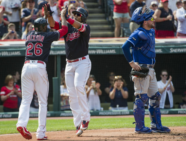 Cleveland Indians' Edwin Encarnacion, right, is greeted at home plate by Austin Jackson after hitting a two-run home run off Kansas City Royals starting pitcher Danny Duffy as Royals catcher Cam Gallagher turns away during the fourth inning of a baseball game in Cleveland, Sunday, Sept. 17, 2017. (AP Photo/Phil Long)