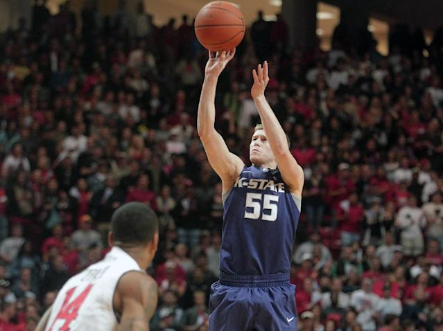 Kansas State's Will Spradling (55) shoots over Texas Tech's Robert Turner (14) during an NCAA college basketball game in Lubbock, Texas, Tuesday, Feb, 25, 2014. (AP Photo/Lubbock Avalanche-Journal, Stephen Spillman)