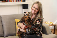 Katherine Sofoluke with her dog George at her home in Beckenham, Greater London, Tuesday, Aug. 13, 2019. Across Europe, pet owners like Katherine are seamlessly crossing borders with their beloved dog, cat or even ferret, thanks to the EU Pet Passport scheme. Now, as a no-deal Brexit looms for Britain, free pet travel is under threat. (AP Photo/Natasha Livingstone)