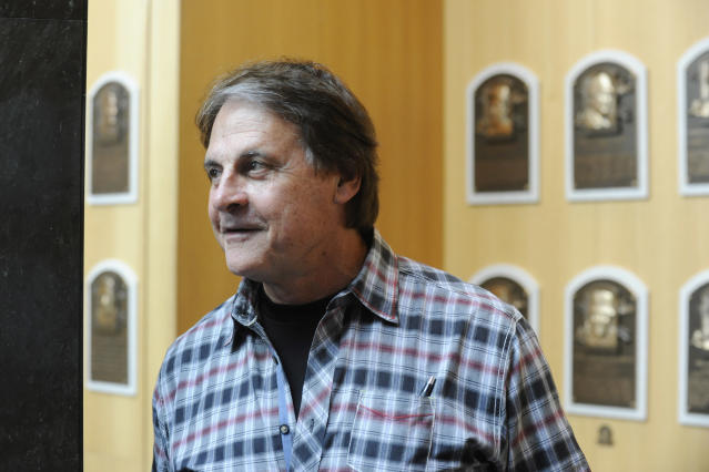 Baseball Hall of Fame inductee Tony La Russa views plaques at the National Baseball Hall of Fame and Museum in Cooperstown, N.Y., Thursday, April 10, 2014. La Russa is scheduled to be inducted into the hall this summer. (AP Photo/Tim Roske)