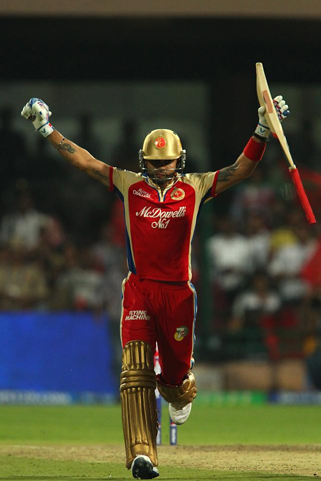 Virat Kohli celebrates the win during match 9 of of the Pepsi Indian Premier League between The Royal Challengers Bangalore and The Sunrisers Hyderabad held at the M. Chinnaswamy Stadium, Bengaluru on the 9th April 2013..Photo by Ron Gaunt-IPL-SPORTZPICS ..Use of this image is subject to the terms and conditions as outlined by the BCCI. These terms can be found by following this link:..https://ec.yimg.com/ec?url=http%3a%2f%2fwww.sportzpics.co.za%2fimage%2fI0000SoRagM2cIEc&t=1506118495&sig=QZjTc.qruAZgUGsLmIw8UQ--~D