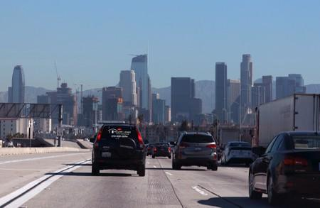 FILE PHOTO: A highway carpool lane sits empty as traffic makes its way into Los Angeles