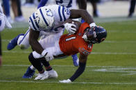 Chicago Bears' Darnell Mooney (11) is tackled by Indianapolis Colts' Justin Houston (50) during the first half of an NFL football game, Sunday, Oct. 4, 2020, in Chicago. (AP Photo/Nam Y. Huh)