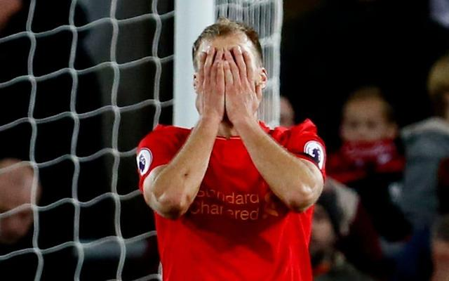 <span>Ragnar Klavan sums up the mood at Anfield after a disappointing draw</span> <span>Credit: Reuters </span>