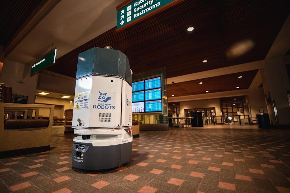 A mobile robot made by San Jose-based Fetch Robotics cleans the airport in Albuquerque.