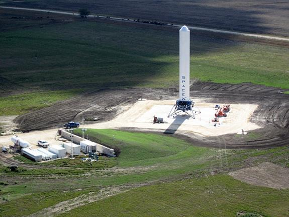 Grasshopper consists of a Falcon 9 rocket first stage, Merlin 1D engine, four steel landing legs with hydraulic dampers, and a steel support structure. For a sense of its scale, note the blue pick-up truck to the left of Grasshopper in the phot