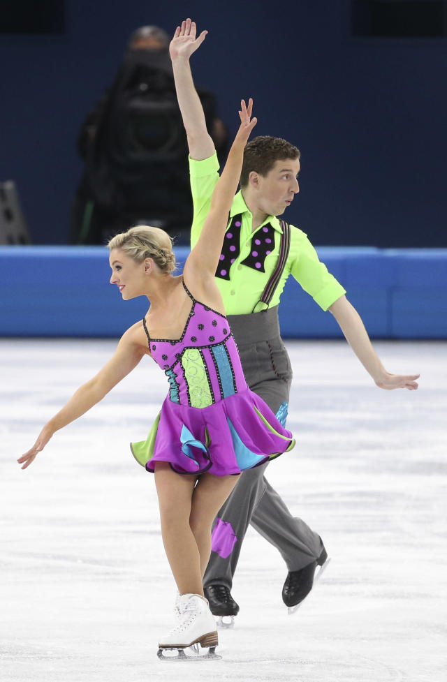 <p>The Australian pair also went the colorful route, but chose neon colors instead of pastel.And they didn't just stop with blocks of bright purple, green and blue. They also added polka dots to her top and his bow tie as well. </p>