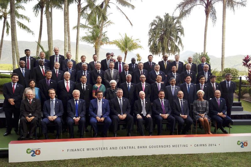 Delegates of the G20 Finance Ministers and Central Bank Governors Meeting pose together during an official photograph in the northern Australian city of Cairns September 20, 2014. REUTERS/Lincoln Feast/Files