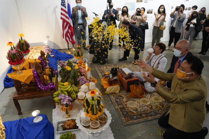 Thai and U.S. officials participate in a ceremony to return two stolen hand-carved sandstone lintels dating back to the 9th and 10th centuries to the Thai government Tuesday, May 25, 2021, in Los Angeles. The 1,500-pound (680-kilogram) antiquities had been stolen and exported from Thailand — a violation of Thai law — a half-century ago, authorities said, and donated to the city of San Francisco. They had been exhibited at the San Francisco Asian Art Museum. (AP Photo/Ashley Landis)