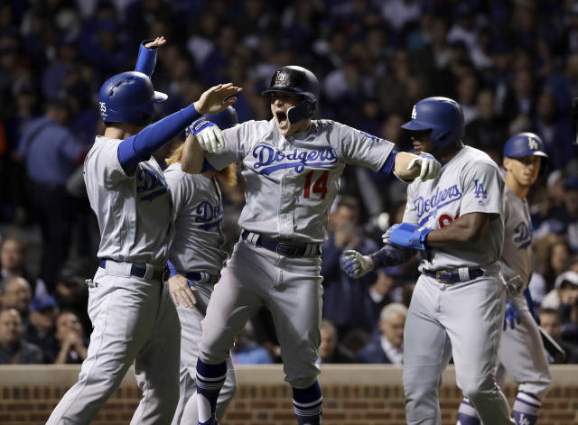 Enrique Hernandez (14) celebrates after hitting a grand slam during the third inning of Game 5 of the NLCS. (AP)