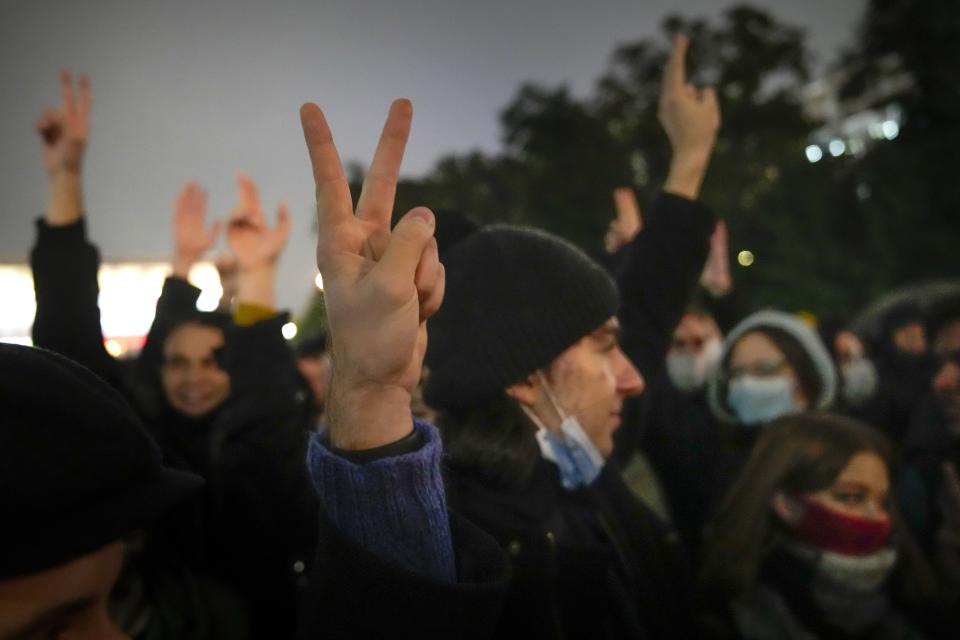 People gesture while listening to a speaker during a protest against the results of the Parliamentary election in Moscow, Russia, Monday, Sept. 20, 2021. The results in the other six regions that were allowed to vote online have been detailed. In Moscow, approval of the ruling party has always been particularly low and protest voting has been widespread. Candidates from the Communist Party called for demonstrations later in the day. (AP Photo/Pavel Golovkin)
