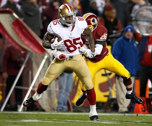 San Francisco 49ers tight end Vernon Davis is wrapped up by Washington Redskins cornerback Josh Wilson during the first half of an NFL football game in Landover, Md., Monday, Nov. 25, 2013. (AP Photo/Alex Brandon)