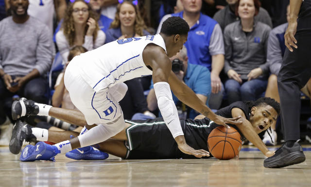 Duke's RJ Barrett and Stetson's Jahlil Rawley, right, chase the ball during the first half of an NCAA college basketball game in Durham, N.C., Saturday, Dec. 1, 2018. (AP Photo/Gerry Broome)