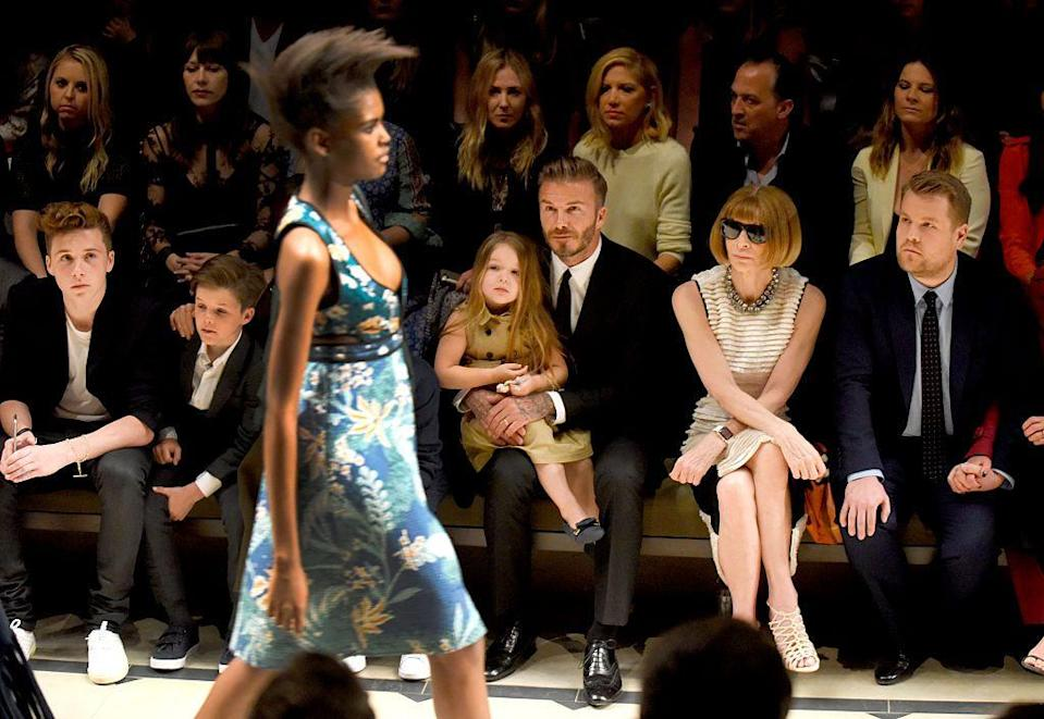 <p>The seats next to <em>Vogue </em>editor in chief Anna Wintour are hot commodities, so it's not your average child who snags one of them. But of course, Harper Beckham isn't your average child — she's the daughter of soccer player David Beckham and fashion designer (and former Spice Girl) Victoria Beckham, who's show they were attending.</p>