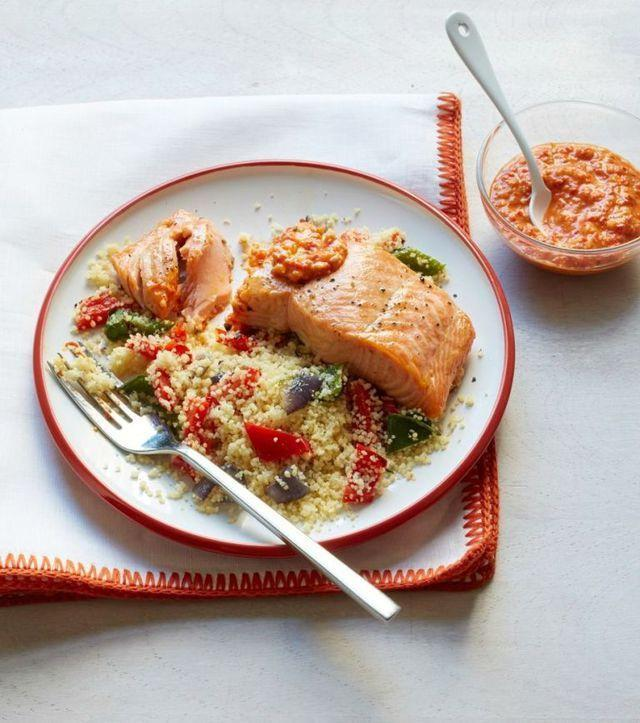 """<p>There's an extra dose of omega-3 fatty acids in this dinner, thanks to the almonds blended into the romesco sauce. </p><p><em><a href=""""https://www.womansday.com/food-recipes/food-drinks/recipes/a53277/broiled-salmon-and-peppers-with-romesco-sauce/"""" rel=""""nofollow noopener"""" target=""""_blank"""" data-ylk=""""slk:Get the recipe for Broiled Salmon and Peppers with Romesco Sauce"""" class=""""link rapid-noclick-resp"""">Get the recipe for Broiled Salmon and Peppers with Romesco Sauce</a></em></p>"""