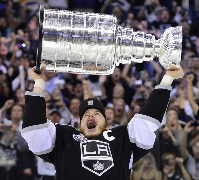 Los Angeles Kings captain Dustin Brown hoists the Stanley Cup after the Kings beat the New Jersey Devils 6-1 during Game 6 of the NHL hockey Stanley Cup finals, Monday, June 11, 2012, in Los Angeles. (AP Photo/Mark J. Terrill)