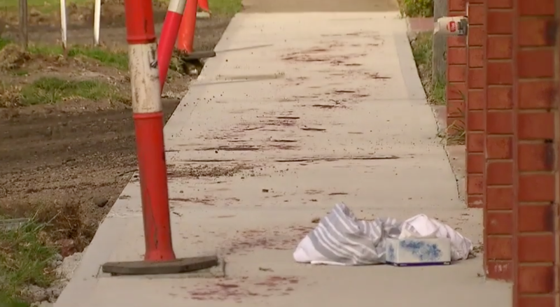 A stretch of pavement covered in blood from the stabbings. Source: Nine News