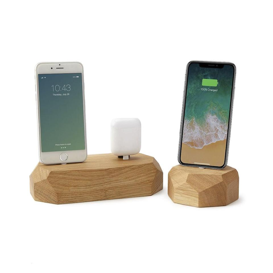 <p>This chic <span>Freestanding Oak Phone Dock</span> ($49 - $69) is perfect for someone who can never have enough chargers.</p>