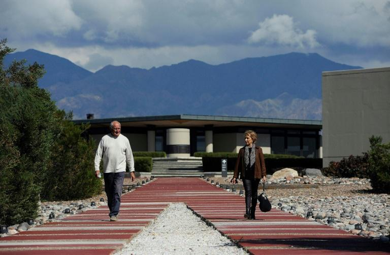 Architects Mario Yanzon (left) and Eliana Bormida walk through one of their master works, the Bodega Alfa Crux in Mendoza, Argentina