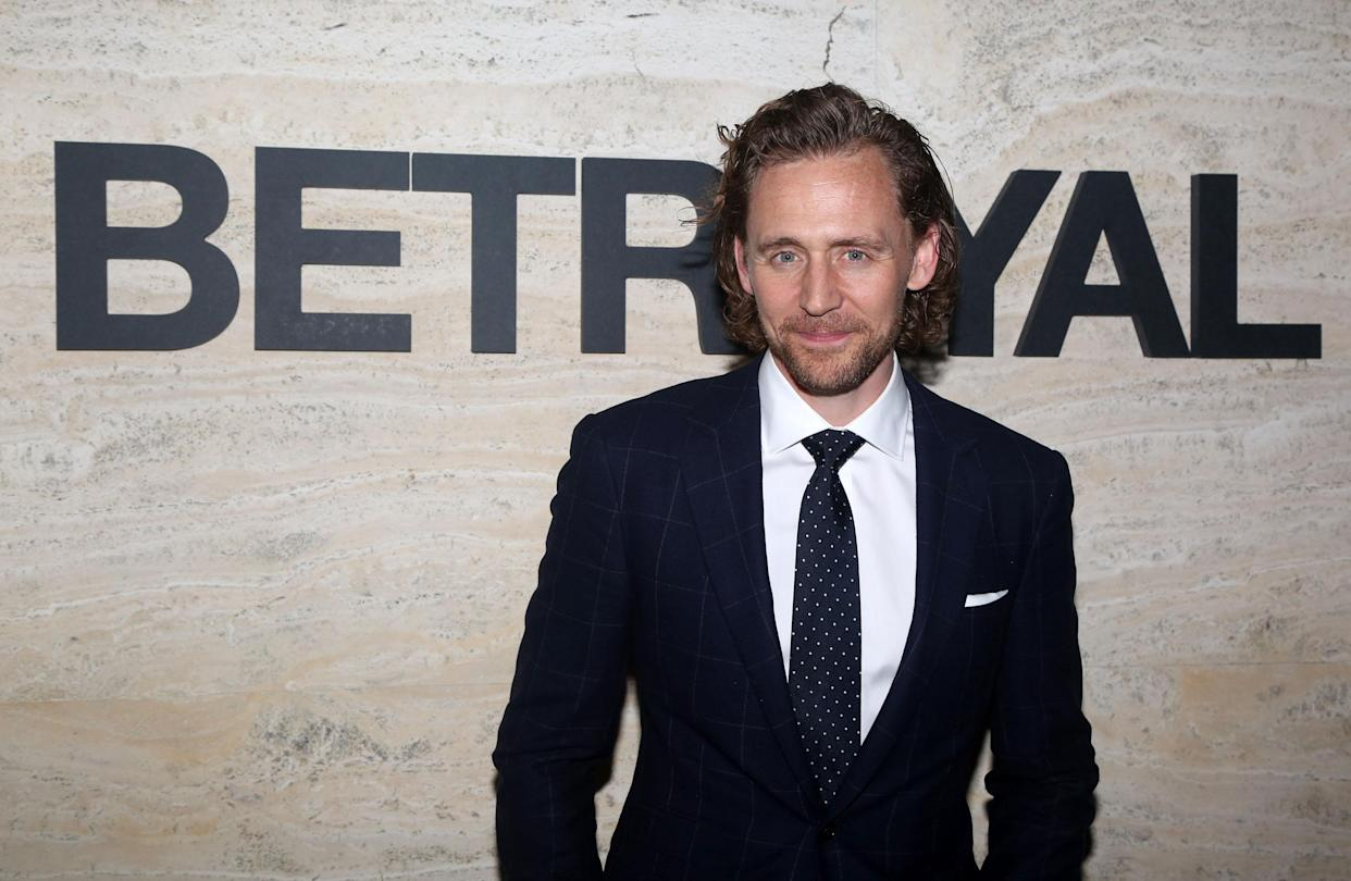 Tom Hiddleston poses at the opening night of