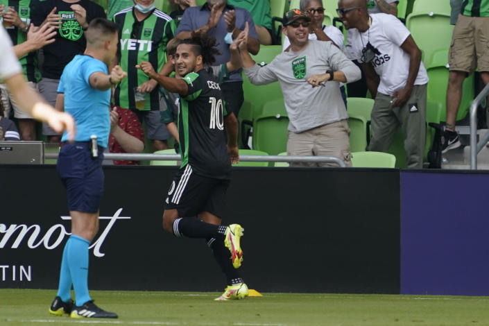 Austin FC forward Cecilio Dominguez (10) celebrates his goal against the Real Salt Lake during the first half of an MLS soccer match in Austin, Texas, Saturday, Oct. 2, 2021. (AP Photo/Chuck Burton)