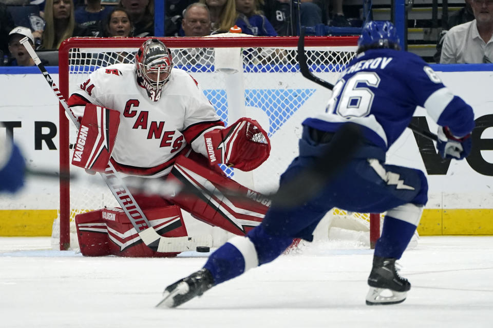 Carolina Hurricanes goaltender Petr Mrazek (34) can't stop a goal by Tampa Bay Lightning right wing Nikita Kucherov during the third period in Game 4 of an NHL hockey Stanley Cup second-round playoff series Saturday, June 5, 2021, in Tampa, Fla. (AP Photo/Chris O'Meara)