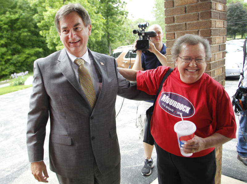 Republican U. S. Senate candidate Richard Mourdock is greeted by supporter Johanna Fultz as he makes a campaign stop Monday, May 7, 2012, at Immanuel Reformed Presbyterian Church near Battle Ground, Ind. Fultz traveled from Logansport to see Mourdock. Mourdock is running against incumbent Sen. Dick Lugar. (AP Photo/Journal & Courier, John Terhune)