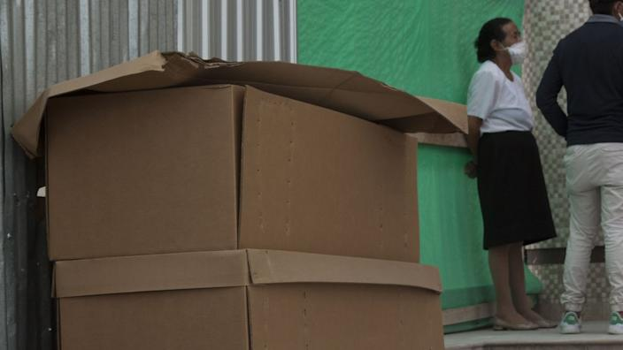 Cardboard coffins have been distributed amid a huge number of deaths