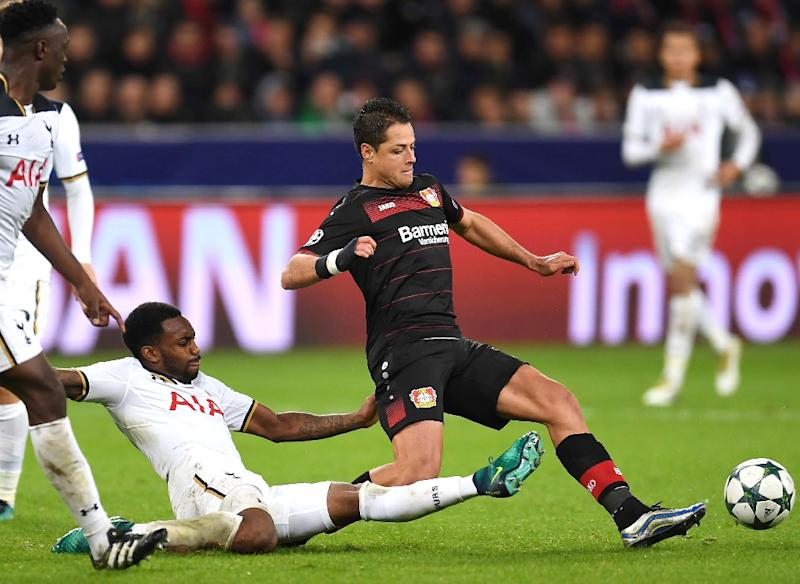 Leverkusen's Mexican forward Javier Hernández Balcázar and Tottenham Hotspur's English defender Danny Rose vie for the ball in Leverkusen, western Germany, on October 18, 2016
