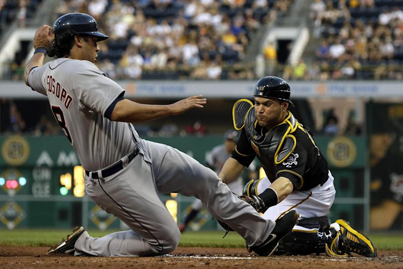 Pittsburgh Pirates catcher Russell Martin, right, tags out Detroit Tigers' Matt Tuiasosopo during the fifth inning of a baseball game in Pittsburgh, Thursday, May 30, 2013. (AP Photo/Gene J. Puskar)