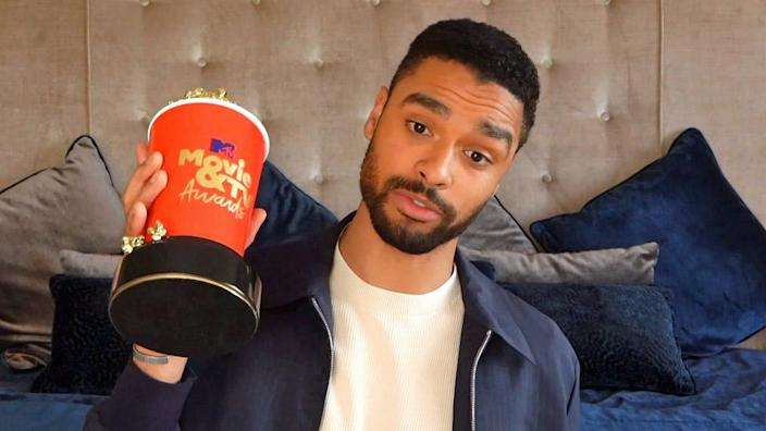 Rege-Jean Page holds his Breakthrough Performance award for Bridgerton during the 2021 MTV Movie & TV Awards in Los Angeles