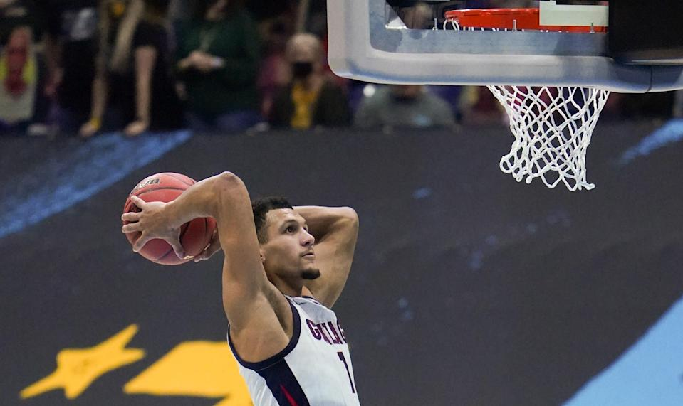 Apr 5, 2021; Indianapolis, IN, USA; Gonzaga Bulldogs guard Jalen Suggs (1) dunks the ball against the Baylor Bears during the national championship game in the Final Four of the 2021 NCAA Tournament at Lucas Oil Stadium. Mandatory Credit: Kyle Terada-USA TODAY Sports ORG XMIT: IMAGN-446986 ORIG FILE ID:  20210409_kkt_st3_239.jpg