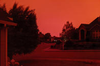 This photo taken from the home of Russ Casler in Salem, Ore., shows the smoke-darkened sky well before sunset, around 5 p.m., Tuesday, Sept. 8, 2020. Strong winds and high temperatures continued to fuel catastrophic fires in many parts of Oregon on Wednesday, forcing thousands of people to flee from their homes and making for poor air quality throughout the West. Huge wildfires also continued to grow in neighboring Washington state. (Russ Casler via AP)