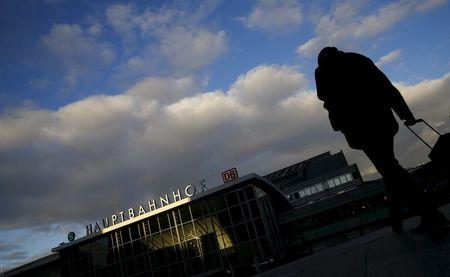 A man walks near the main railway station in Cologne