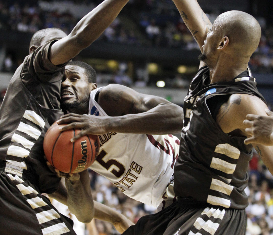 Florida State forward Bernard James (5) gets caught between St. Bonaventure defenders Youssou Ndoye, left, and Da'Quan Cook, right, in the first half of a second-round NCAA college basketball tournament game on Friday, March 16, 2012, in Nashville, Tenn. (AP Photo/Mark Humphrey)