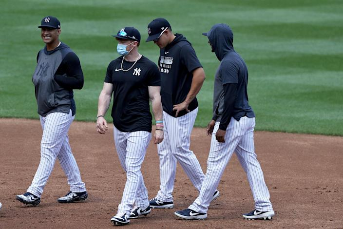 Clint Frazier sports his mask during a Yankees workout. (Photo by Elsa/Getty Images)