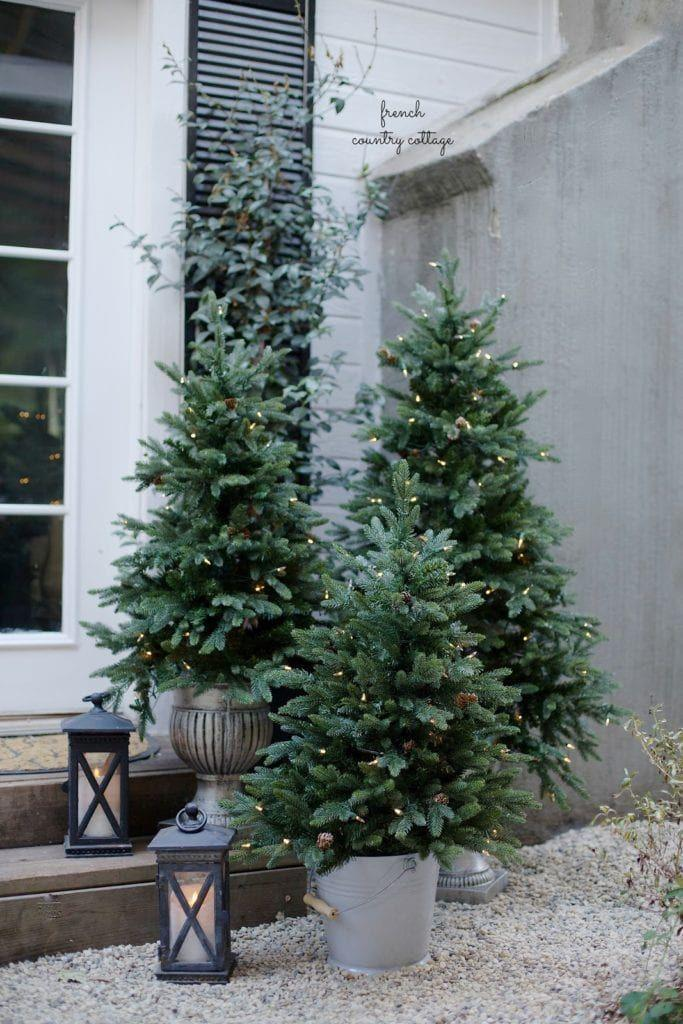 "<p>Nothing says <em>Christmas</em> like a Christmas tree—or three of them. <a href=""https://www.frenchcountrycottage.net/2016/11/french-country-cottage-christmas-home_30.html"" rel=""nofollow noopener"" target=""_blank"" data-ylk=""slk:French Country Cottage"" class=""link rapid-noclick-resp"">French Country Cottage</a> has the most charming setup of miniature trees outside of her house, in mismatched pots and even a super-casual bucket.</p>"