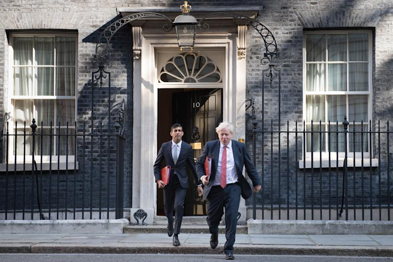 Chancellor of the Exchequer Rishi Sunak (left) and Prime Minister Boris Johnson leave 10 Downing Street, for a Cabinet meeting to be held at the Foreign and Commonwealth Office (FCO) in London, ahead of MPs returning to Westminster after the summer recess. (Photo by Stefan Rousseau/PA Images via Getty Images)