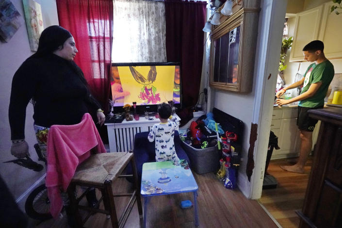 FILE - In this March 10, 2021, file photo, Isabel Miranda, left, speaks to her 4-year-old son, Julian, while her other son, Jayden, 13, prepares hot chocolate in the kitchen of their rental apartment in Haverhill, Mass. A federal judge has ruled, Wednesday, May 5, 2021, that the Centers for Disease Control exceeded its authority when it imposed a federal eviction moratorium to provide protection for renters out of concern that having families lose their homes and move into shelters or share crowded conditions with relatives or friends during the pandemic would further spread the highly contagious virus. Miranda and her family would no longer have this eviction protection if this ruling stands. (AP Photo/Elise Amendola, File)