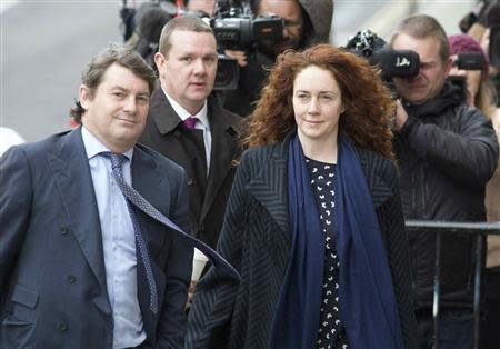 Former News International chief executive Rebekah Brooks and her husband Charlie Brooks arrive at the Old Bailey courthouse in London