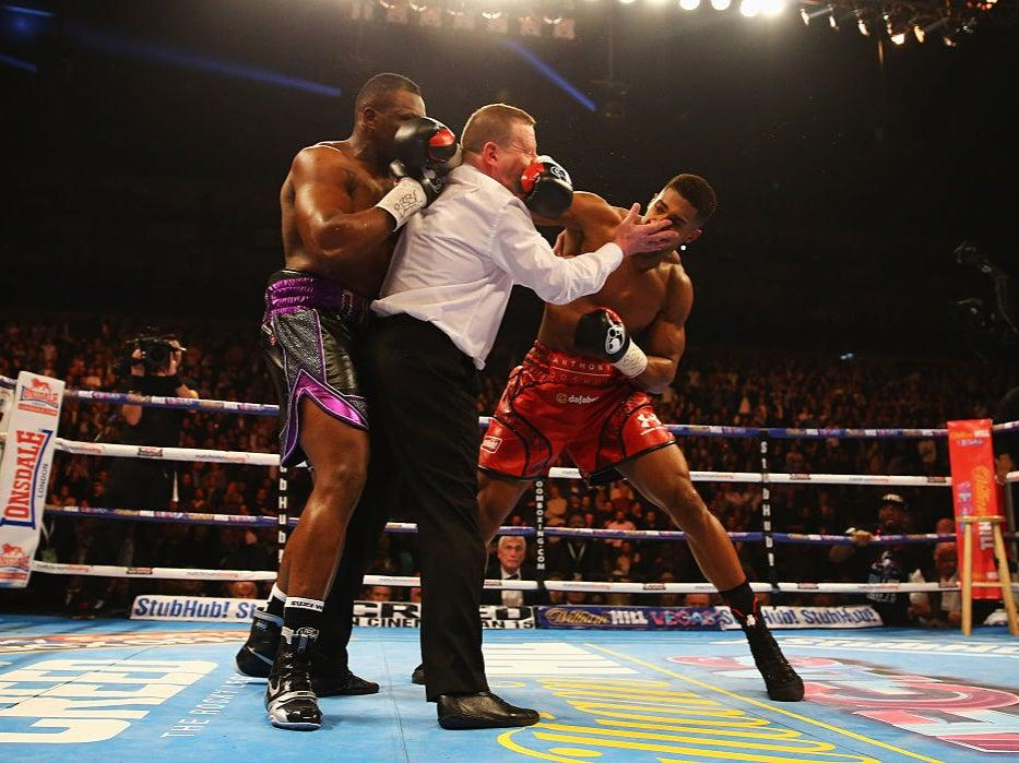<p>Anthony Joshua defeats Dillian Whyte in a high-risk fight in 2015</p>Getty